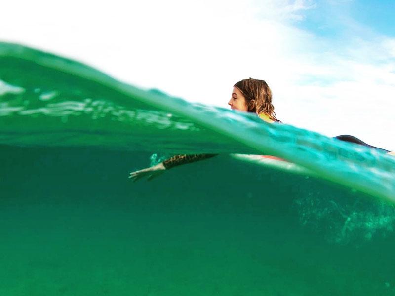 training surf on waves